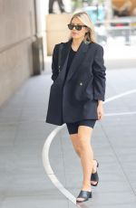 Mollie King Keeps it casual rocking shorts and a smart blazer at BBC Radio One in London