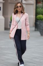 Myleene Klass Looks in good spirits as she arrives in a chic pink blazer and striped trousers at Smooth radio London