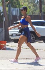 Nicole Murphy Shows off her toned figure while walking her dog with a friend in Hollywood