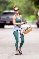 Nina Agdal Smiles As She Carries A Hamper Holding Toiletries After Leaving a Yoga Class in Amsgansett Hamptons New York