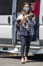 Olivia Munn Having her dogs attended to in a pet grooming van in Los Angeles