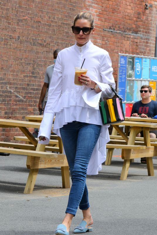 Olivia Palermo Looks gorgeous in skinny jeans, paired with a pretty white blouse, while out getting an iced coffee in New York