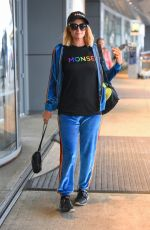 Paris Hilton In a blue velvet track suit and monse pride colors t-shirt as she heads to the airport in NYC