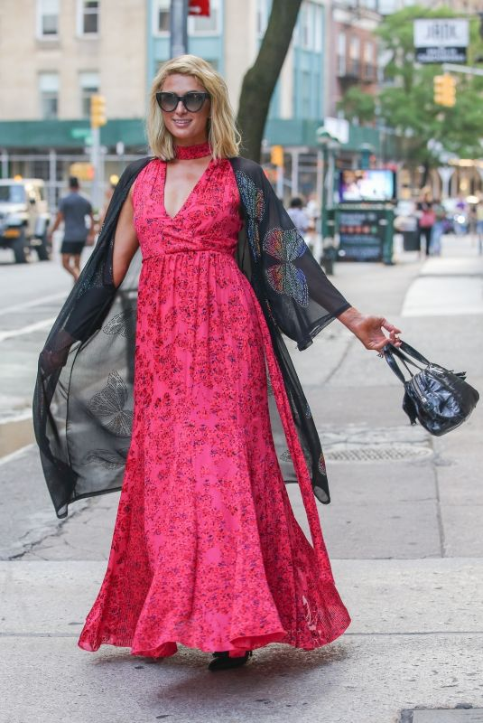 Paris Hilton Looks glamorous while posing for cameras in an elegant floral dress, New York City