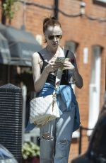Phoebe Dynevor Seen going for a walk on a sunny day in London