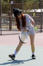 Phoebe Price In high boots and a mesh dress with a bikini underneath seen at the tennis courts