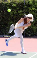 Phoebe Price Pictured posing and hitting tennis balls at the courts
