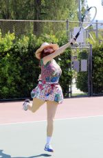 Phoebe Price Posing with an umbrella at the park on Monday in Los Angeles