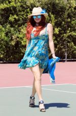 Phoebe Price Seen posing in a turquoise sunflower dress at the tennis courts on Tuesday in Los Angeles