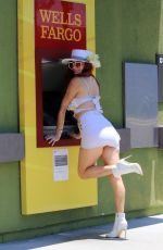 Phoebe Price Seen smiling and posing while grabbing some cash at the Wells Fargo ATM in Los Angeles
