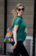 Rachel Riley Shows off her ever growing baby bump in a tight fitted green top as she leaves the Countdown Studios at Media City in Salford