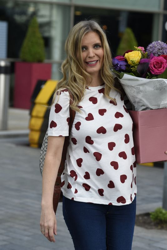 Rachel Riley Shows off her growing baby bump as she carries a big bunch of flowers while leaving Countdown studios after filming at Media City in Salford