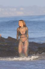 Rita Ora In a sheer dress while recording her new music video on the beach In Malibu