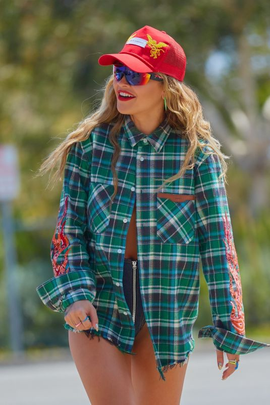 Rita Ora Shows her bright smile as she rocks a sexy outfit while recording her new music video In Malibu