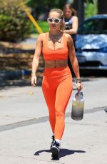 Rita Ora Shows off her toned physique heading to pilates in a bright orange outfit, Los Angeles