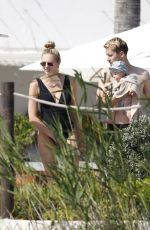 Romee Strijd Showed off her incredible post-baby body in black one-piece swimsuit in Ibiza