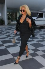 Saweetie (Diamonté Harper) Shows off her curves in a simple, classy look while attending a meeting at the Pendry Hotel in West Hollywood