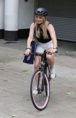 Sian Welby Looks hot in tiny white shorts as she cycles home from work in pink wheeled bicycle in London