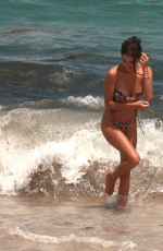 Tao Wickrath Hit by a wave in the water as she enjoys a hot day at the beach in Miami