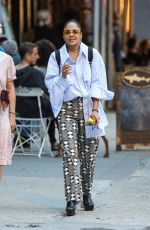 Tessa Thompson Is spotted smoking a cigarette with a friend while on a walk on the streets of New York