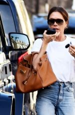 Victoria Beckham Looked casual yet stylish out on a blazing hot day out in London
