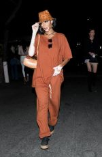 Winnie Harlow Keeps it casual in a baggy brown two-piece while leaving Zack Bia