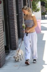 Alexis Ren With her adorable dog Angel getting coffee from Joe & the Juice in Los Angeles