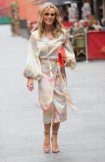 Amanda Holden Looks chic in wrap dress at Heart radio in London