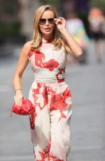 Amanda Holden Turn heads in a striking red and white jumpsuit at Heart radio in London