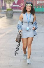 Amber Gill Shows off her flawless beauty in a chic grey t shirt dress with stylish face paint and flowers for Capital Radio