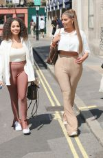 Amber Gill Steps out from Heat TV with Anna Vakilli in blonde hair and crop-top wearing very tight trousers in London