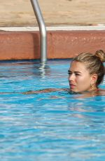 Arabella Chi Relaxing by the pool while on holiday in in Ibiza