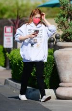 Ariel Winter Checks her phone as she goes to Gelson