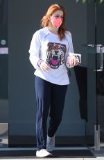 Ariel Winter Wears a red mask to match her new red hair while out shopping in Los Angeles