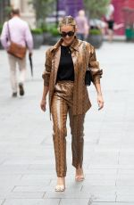 Ashley Roberts Looks hot in vinyl suit at Heart radio in London