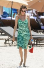 Behati Prinsloo Looks great in a green dress as she wraps up a beach day in Miami Beach