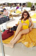 Blanca Blanco Slips into a sexy yellow bikini and models on the beaches of Cannes