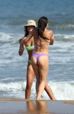 Brooks Nader Takes a swim in Montauk beach in Hamptons with her husband Billy Haire and her sister Grace Ann Nader