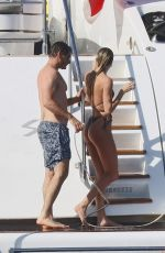 Candice Swanepoel Wearing a bikini on a boat in the French Riviera