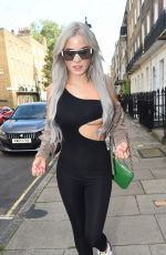 Carla Howe Suffers a major boob slip while out and about in London