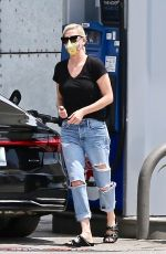 Charlize Theron Stops to fill up her tank while running weekend errands in West Hollywood