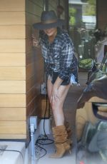 Chrissy Teigen Brings her new basset hound puppy Pearl along for a visit to her office in Santa Monica
