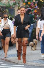 Chrissy Teigen Steps out in thigh-high boots with friends in New York