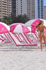 Cindy Prado Shows off her cuvers in many swimsuits while shooting content on the beach in Miami