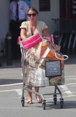 Coleen Rooney Wears a floral little number as she stocks up on supplies with a trolley full of groceries out in Wilmslow, Cheshire