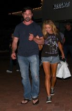 Denise Richards & her husband walk arm in arm as they leave after dinner with her daughter Eloise at Lucky