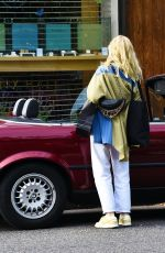 Ellie Bamber Seen driving a classic red BMW while shopping in London