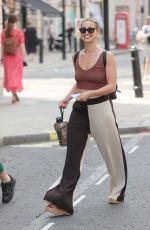 Ferne McCann Looks stunning flashing her washboard abs running business errands in two tone trousers and vest in London