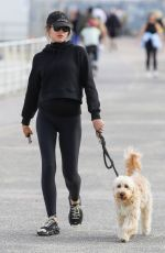 Georgia Fowler Pictured enjoying a walk with her pooch in Sydney