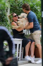 Georgina Burke As she cuddles her pet pooch whilst she enjoys a drink with friends in Soho, New York